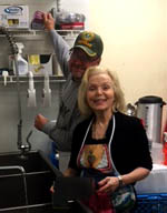 Joe Stephany and Charlotte Pipes working hard in the kitchen at Deutsches Haus.